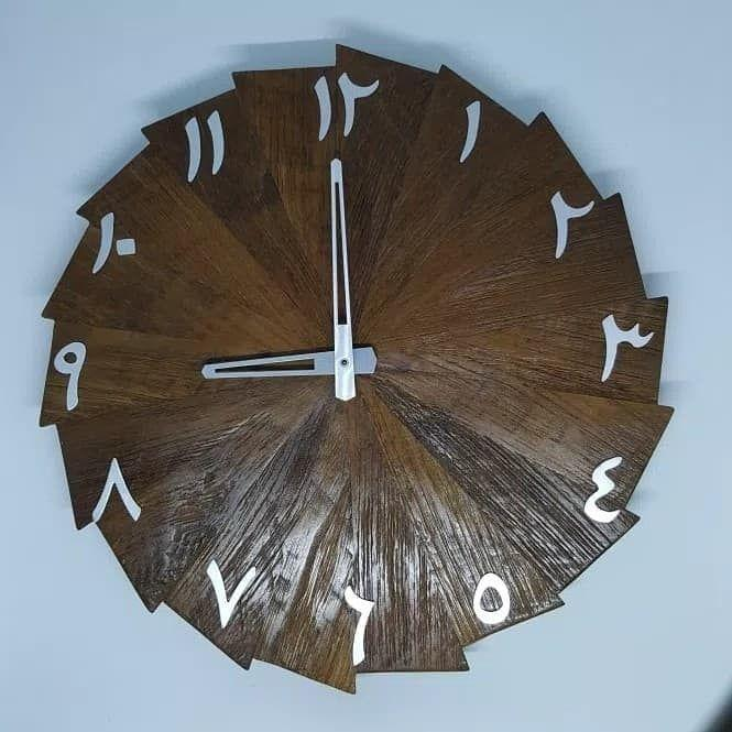 Jam Dinding Unik Model Kincir Angin Dengan Angka Arab