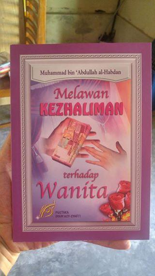 Buku Melawan Kezhaliman Terhadap Wanita cover